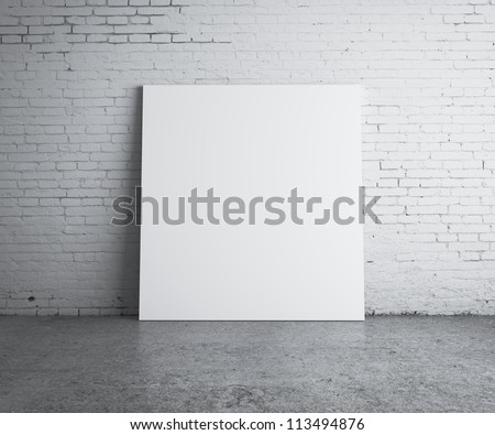 blank picture hanging on wall - stock photo