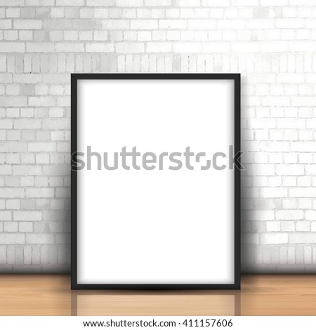 Blank picture leaning against a brick wall