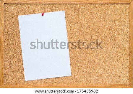 blank piece of white A4 paper pinned to a cork board / bulletin board with a wooden frame