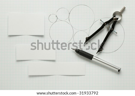 Blank pieces of paper with pen & compass - stock photo