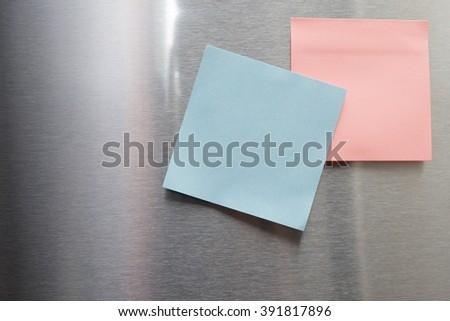 BLANK POST IT ON STAINLESS STEEL REFRIGERATOR DOOR - stock photo