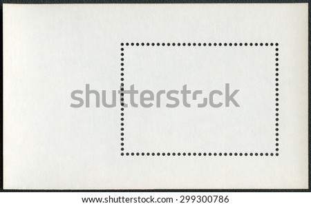 Blank postage stamp block souvenir sheet on a black background - stock photo