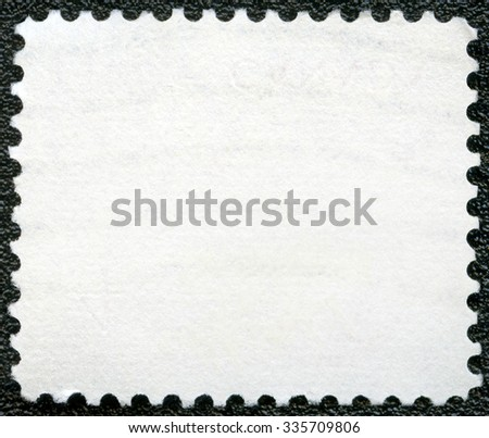 Blank postage stamp sheet on a black background - stock photo