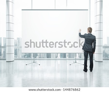 blank poster and drawing businessman - stock photo