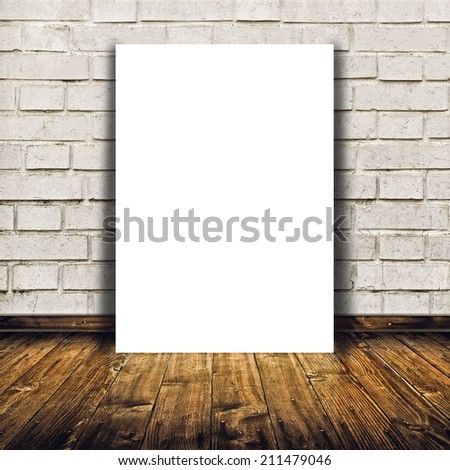 Blank poster as copy space template for your artwork or design in Vintage empty Room interior with white brick brick wall and wooden floor. - stock photo