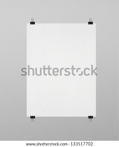 blank poster clips on white wall - stock photo
