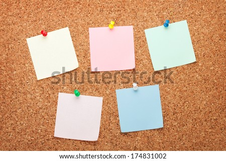 Blank postit notes on cork wood notice board - stock photo