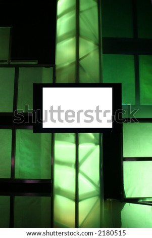 Blank Presentation Monitor on Stage with Green Lights - stock photo