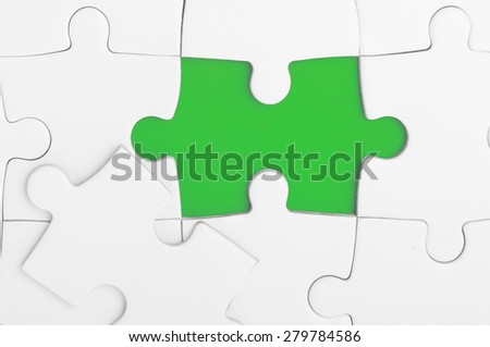 Blank puzzle shape in green colours - stock photo