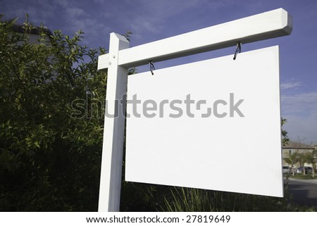 Blank Real Estate Sign in Neighborhood Ready for Your Own Message. - stock photo
