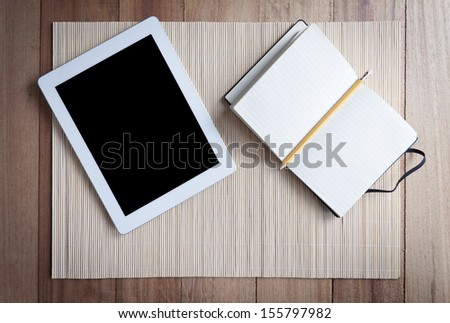 Blank recipe book with tablet e pencil - stock photo