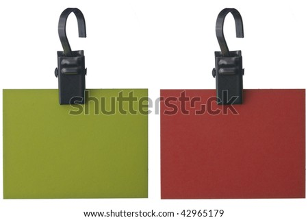 Blank red and green paper notes with clip isolated on white background. - stock photo