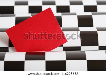 Blank red paper for text on black and white checkered background