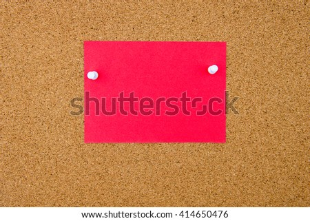 Blank red paper note pinned on cork board with white thumbtacks, copy space available