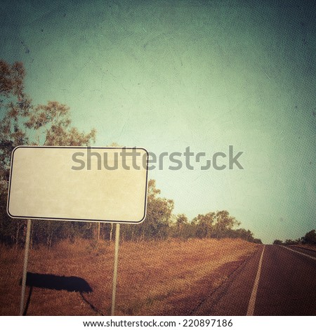 Blank road sign on the road - stock photo