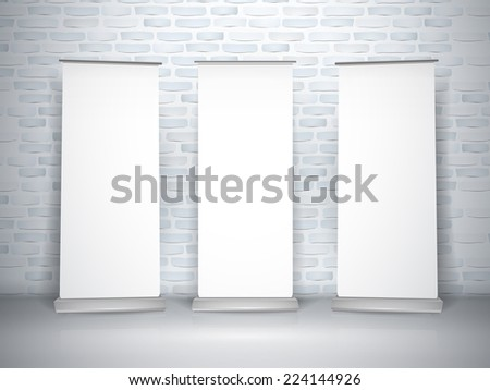 blank roll up banners set isolated over brick wall - stock photo