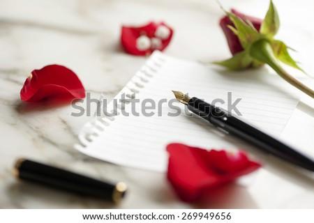 blank rose letter  - stock photo