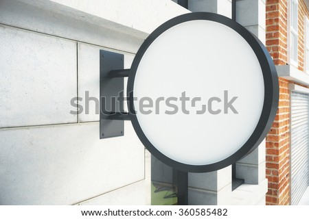 Blank round white signboard on the wall outdoor, mock up - stock photo