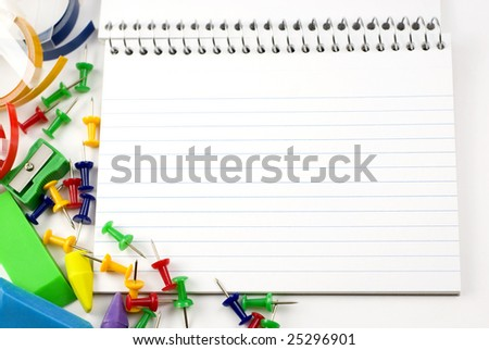 Blank ruled index card with colorful school and office supplies around edge  copy space - stock photo
