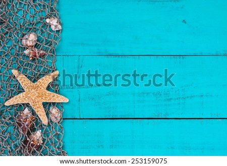 Blank Rustic Antique Teal Blue Aged Wooden Sign Background With Fish Net Border Seashells And
