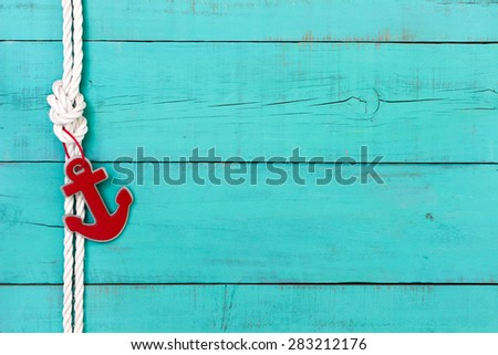 Blank rustic teal blue wooden nautical sign with red anchor and white rope border - stock photo