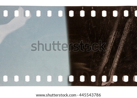 Blank scratched noisy filmstrip isolated on white background - stock photo