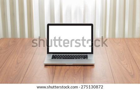 Blank screen laptop computer on wood background