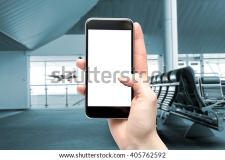 Blank screen smartphone with space for copy at the airport, filtered and digitally modified. - stock photo