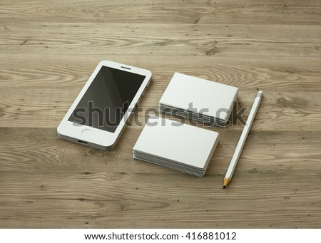 Blank set white business cards white stock illustration 416881012 blank set of white business cards and white smartphone laid out on wooden surface personal colourmoves