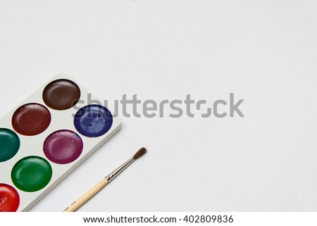 Blank sheet and ink drawing with a brush on the table. Children's everyday life. - stock photo