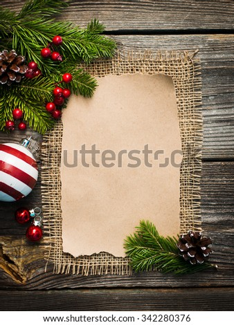 blank sheet for New Year's greetings decorated Christmas tree and pine cones
