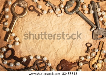 Blank sheet of crumpled paper, framed different old keys - stock photo