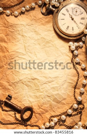 Blank sheet of crumpled paper, framed in antique items - stock photo