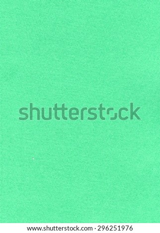 Blank sheet of light green paper useful as a background - stock photo