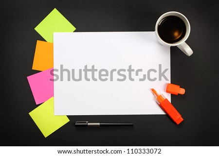 Blank sheet of paper, sticky notes, pen, highlighter and cup of coffee on black office table. - stock photo