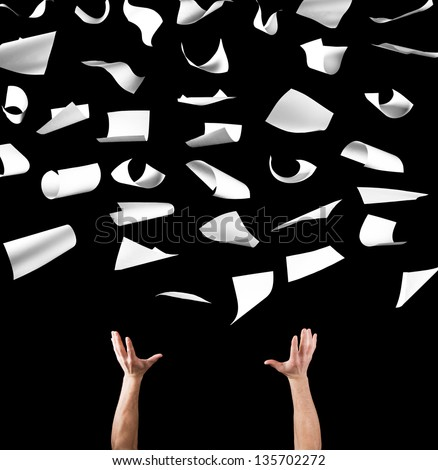 Blank sheets of paper floating in the air with two arms holding them. - stock photo
