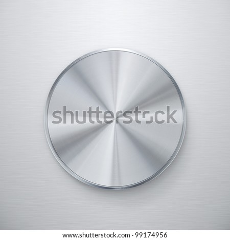 Blank shiny silver knob or push button over brushed metal background - stock photo