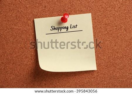 Blank Shopping List is pinned on corkboard. - stock photo
