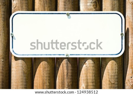 blank sign at a fence - stock photo