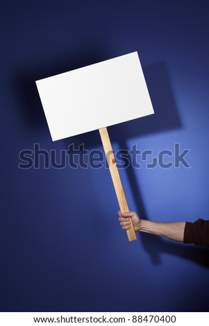 Blank sign held by hand and customizable with your message. - stock photo