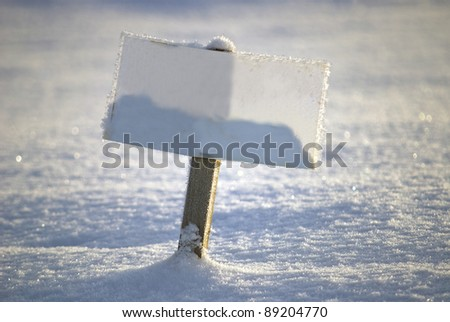 Blank sign in the winter scene, copy space for your own text or image - stock photo