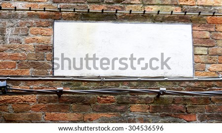 blank sign on brick wall in Venice, Italy