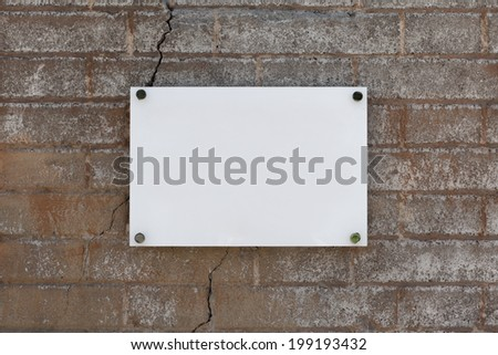 Blank sign on the wall texture - stock photo