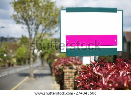 Blank sign outside a house on a road - stock photo