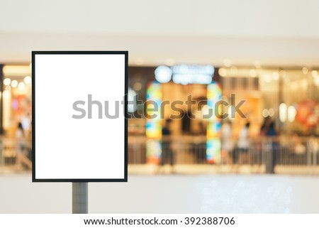 Blank sign with copy space for your text message or content in modern shopping mall. - stock photo