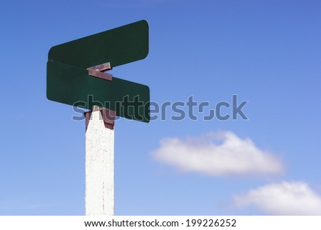 Blank Signs Crossroads Street Avenue Sign Blue Skies Clouds - stock photo