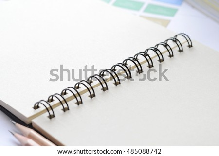Blank sketched book on desk with copy space for writing your idea,high key tone.
