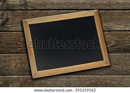 blank slate on wood background  - stock photo
