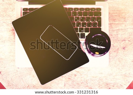 Blank smartphone on the tablet with coffee mug and laptop keyboard, mock up, instagram photo effect - stock photo