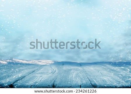Blank space on wooden boards in winter snowing time - stock photo